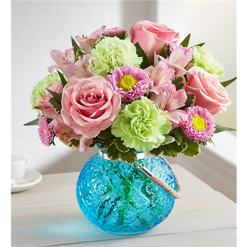 winter-bouquet-with-roses-and-other-mix-flowers-in-a-beautiful-blue-vase